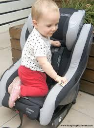 playing on a mazi cosi car seat
