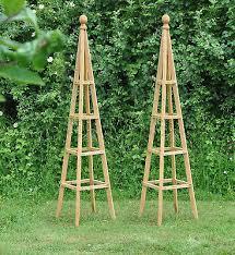 tall wooden garden obelisks for roses