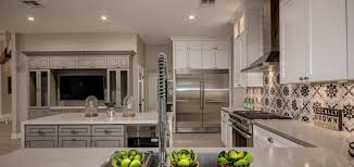 this kitchen remodel in scottsdale az features quartz countertops j k white greige cabinets the crown molding stainless steel appliances