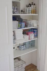 organized bathroom closet simply organized how to organize deep bathroom closet