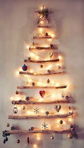 Via Pinterest: Find some driftwood or random fallen branches. Use some  clear command hooks. Wall Christmas TreeXmas ...