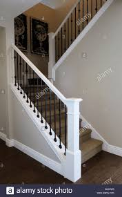 wrought iron railing. An Stairway With Wrought Iron Railing And Carpet Stairs Globe Art In The Corner.