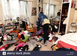 Superb Teenage Girl In Her Messy Bedroom England Stock Photo
