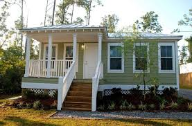 How Much Does A Tiny House Cost To Build Prefab Home Wooden Stairs Siding Wall Mounted Lighting White Railing