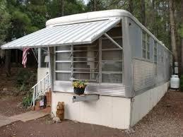 a 1959 spartan carousel trailer with a