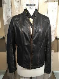 black leather jacket with bronze finish and zip pockets
