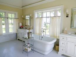 stunning master bathroom with pale yellow walls and vaulted ceiling