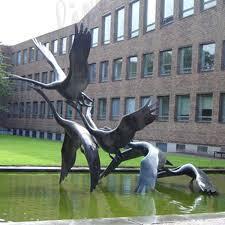 large outdoor crane statue antique