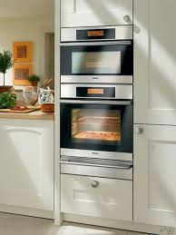 miele masterchef h4000 series h4082bmss shown with h4682b single wall oven and warming drawer