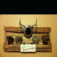 wall decor shelf for hunting room made from an old pallet ideas lodge living fishing