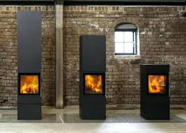 wood stove glass door above danish architect the highly efficient cubic wood stoves all the models have the same highly efficient fire box and are fireplace