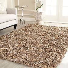 The different types of these rugs are on the basis of the material used for  the