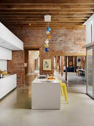 Brick Kitchen Flooring Polished Cement Floors Exposed Brick And Beams Sleek White