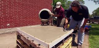 pouring concrete in the form for a concrete countertop