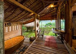 apart from that we also adore the bathroom that comes with an earthy tone bathtub in an open setting be one with nature while you soak in a relaxing dip
