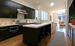 view in gallery black cabinets and white marble countertop in the kitchen