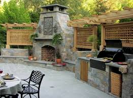 View in gallery fireplace and outdoor summer kitchen e1347569397117  Creating the Ideal Outdoor Summer Kitchen this Fall
