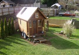 how much do tiny houses cost. Dee Williams\u0027 Kozy Kabin Tiny House Parked In A Yard. How To Find Much Do Houses Cost