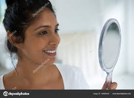 woman holding hand mirror. Smiling Woman Holding Hand Mirror \u2014 Stock Photo