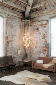 industrial style home lighting. old weathered brick wall and exposed wood beams this is such a great space industrial living rooms loft with walls style home lighting