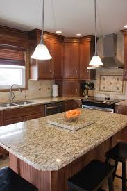 Granite With Cream Cabinets Maple Nutmeg Cabinets With Granite Tops And Light Colored Floor