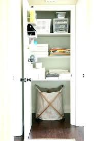 prestigious linen cabinet with hamper j7522675 tips