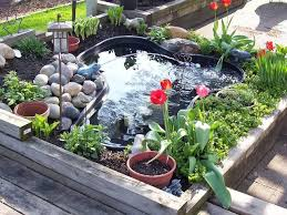 Small Picture pond in a raised bed Small Garden Ponds Pinterest Small