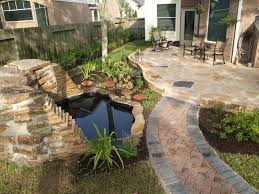 Lawn Garden Landscaping Idea For Your Backyard On Front Yard With Small  Pond And Concrete Pavement