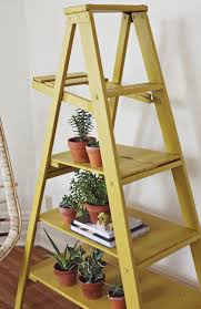 DIY ladder display shelves. I love this! Cute idea for a covered porch,