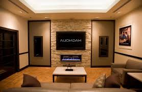modern insert electric fireplace under tv wall paired with brown