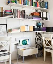 office in living room. corner home office with 2 desks and zebra accents in living room