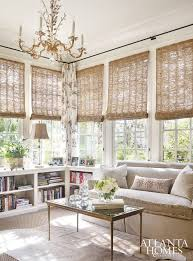 neutral half wall corner bookcase woven window shades ornate gold  chandelier for the sun room best 25 sunroom window treatments ideas ...