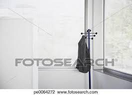 office coat rack. Stock Photo - Suit Jacket Hanging On Office Coat Rack. Fotosearch Search Photography Rack
