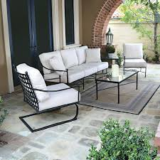 patio furniture glass table patio furniture iron chairs cushioned chair glass table small rug candle and