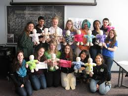 students spend spring break giving back to the community suny  students show off their handmade therapy dolls for the medical university of south carolina children s hospital