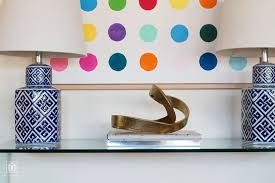 glass console table decor ideas and blue lamp