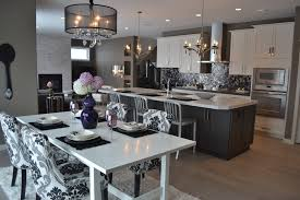 pretty artcraft lighting in kitchen transitional with gray and black kitchen next to spoon and fork wall