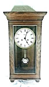 wall clock with pendulum antique wooden dark wood chiming dual pen antique wood pendulum wall