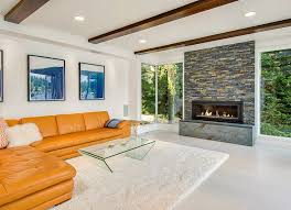 modern living room with fireplace. Modern Living Room With Large Fireplace And Exposed Wood Beamed Ceiling