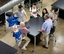 Engineering Dean Ned Thomas (standing At Right) Holds Court At A