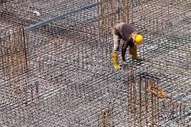 rebar construction a worker is doing a final inspection of the floor reinforcement stock photo rebar worker