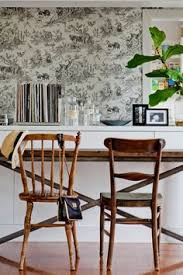 toile wallpaper mismatched dining chairs white wainscoting emily henderson