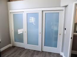 3 panel 2 track ovation sliding closet doors with white laminated glass panels