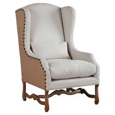 upholstered in off white linen and natural jute this wingback arm chair features an