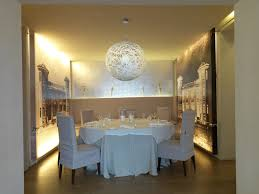 large pendant light over a dining table from lighting company co uk