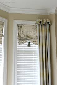 bay window with faux shades and ds framing ends