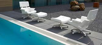 white lounge chair next to swimming pool mal 1956