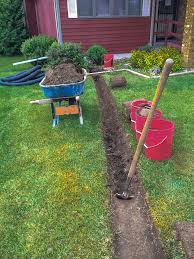 a narrow trench is dug after the sod is temporarily removed