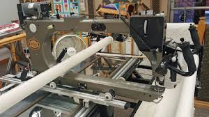 Used Longarm Quilting Machines - Accomplish Quilting & 2004 Gammill Optimum with Statler Stitcher 30-12 on 12' table with poly  stand top and zippered leaders. Adamdwight.com