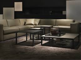 highly regarded gray vinyl sectional sofas with square stone coffee table on gray areas rugs in modern living room furnishing designs